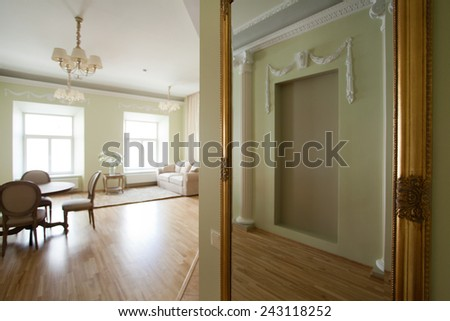 Classical interior of a hallway leading into a dining and living room - stock photo