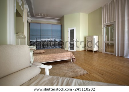 Classical interior of bedroom with a couch in front - stock photo