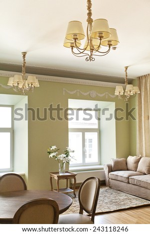 Classical interior of dining table with chairs around - stock photo