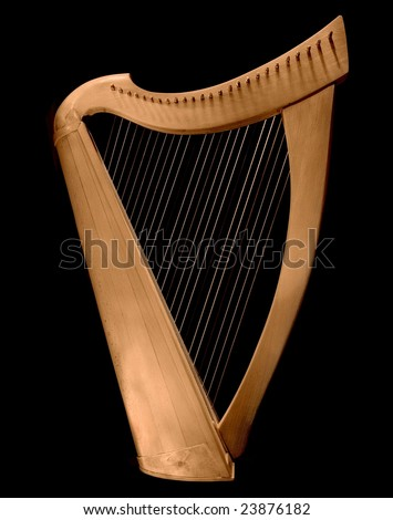 Classical Irish wooden harp on black background.