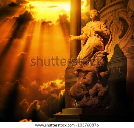 Classical marble statue of a woman with hand out stretched and cherubs at her feet bath in golden light from above - stock photo