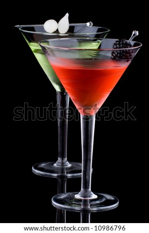 Classical martini in chilled glass over black background on reflection surface, garnished with fresh blackberry and marinated pearl onions. Most popular cocktails series. - stock photo