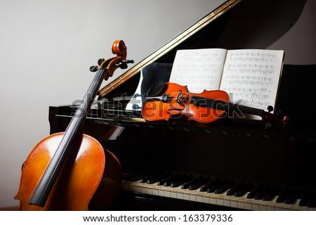 Classical music concept: cello, violin, piano and a score - stock photo
