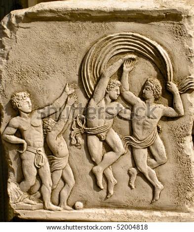 Classical plaque of dancing of men dancing - stock photo