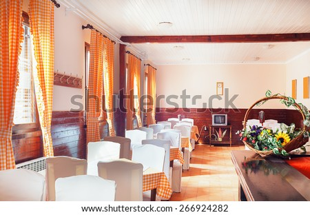 Classical restaurant interior, interesting old style curtains and furniture in white.  - stock photo