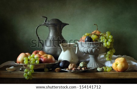 Classical still life with apples and grapes - stock photo