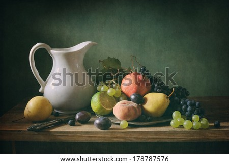 Classical still life with fruit and a white jar - stock photo