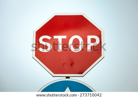 Classical Stop road sign over blue sky background - stock photo