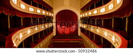 Classical Theater with Red stage curtain with arch lights and shadows. - stock photo