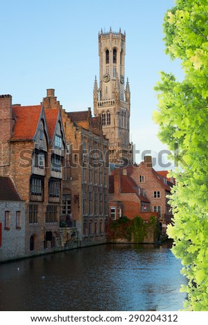 classical view of old Bruges with Belfort tower and canal water at suumer day, Belgium