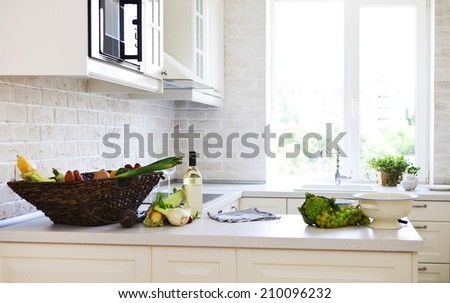Classical white kitchen at home with healthy food - stock photo