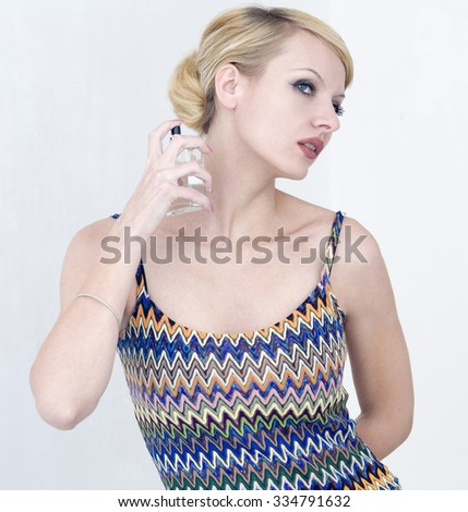 classically dressed girl with perfume - stock photo