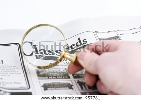 classifieds magnifyed (CLASSic way to search for a job or real estate or whatever...) - stock photo