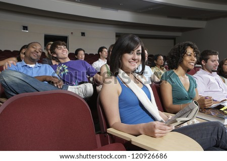 Classmates sitting  in classroom during lecture