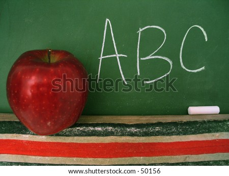 Classroom chalkboard with apple. - stock photo