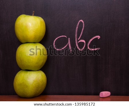 Classroom chalkboard with apples. - stock photo
