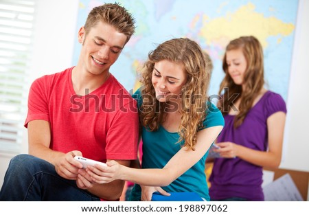 Classroom: Friends Compare Report Cards For Semester - stock photo
