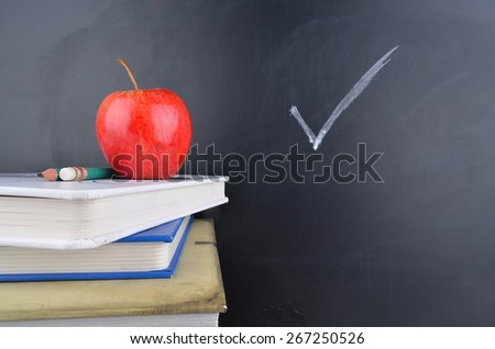 Classroom with apple,books and blackboard - stock photo