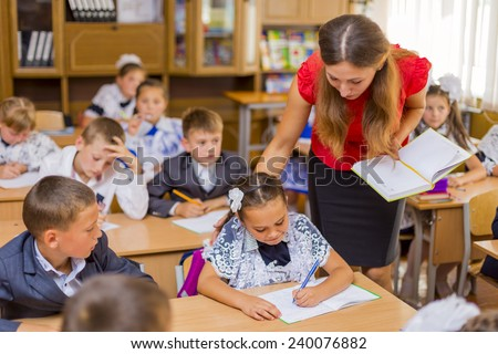 classroom with children and teacher - stock photo