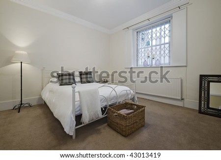 classy bedroom with decorative accessories and a free standing lamp - stock photo