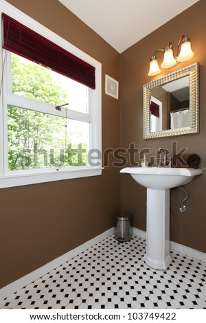 Classy Brown small bathroom with antique sink and tiles - stock photo
