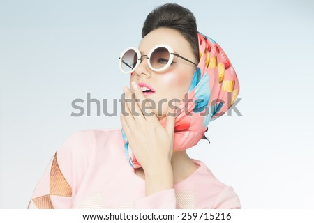 Classy chic sixties style fashion retro woman. Sunglasses and silk scarf. - stock photo
