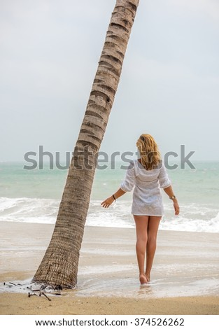 Classy woman on the tropical  beach