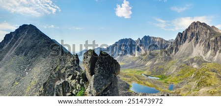 Clastic rock and a view of the mountain valley. TUNKA ridge. Eastern Siberia - stock photo