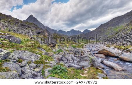 Clastic rocks near the mountain river. Eastern Sayan. Buryatia - stock photo