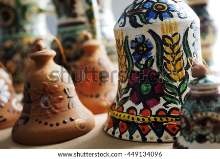 clay bells in the pottery workshop - stock photo