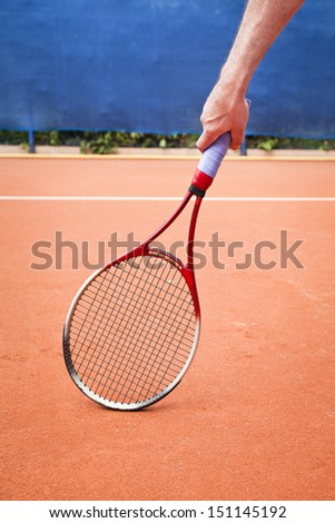 clay court and tennis racket - stock photo