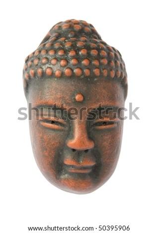 Clay figure of a Buddha head - stock photo