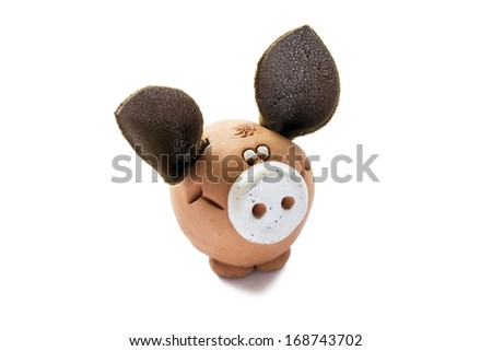 Clay figurine of pig with big leather ears on white background - stock photo