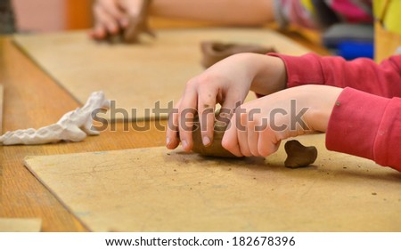 Clay in child hands - stock photo