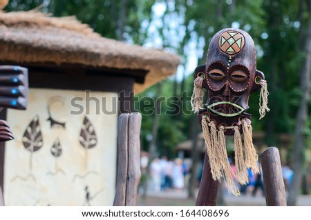 Clay mask of a Maya warrior with tattoos and ear spools. - stock photo