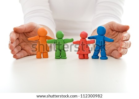 Clay people family protected by woman hands - life insurance concept - stock photo