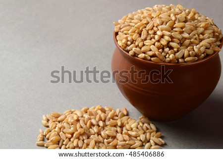 Clay pot with a wheat grain.