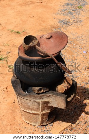 Clay Pot with Boiled Water on Fire Stove, Thailand. - stock photo