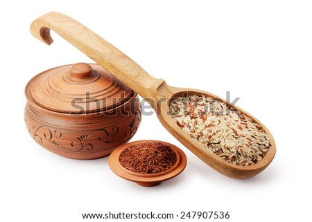 clay pot, wooden spoon and saucer with rice isolated on white background