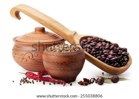 clay pot, wooden spoon, lentils, beans and spices isolated on white background - stock photo
