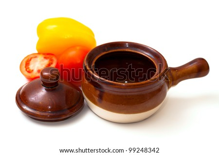 clay pots and vegetables isolated on white background