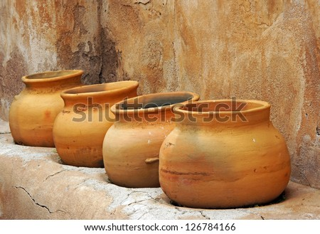 Clay pots on a shelf in the Tumacacori Mission store room - stock photo