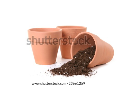 Clay Pots Waiting To Be Planted With Seeds for Springtime - stock photo