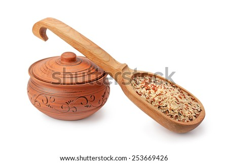 clay pots, wooden spoon and rice isolated on white background - stock photo
