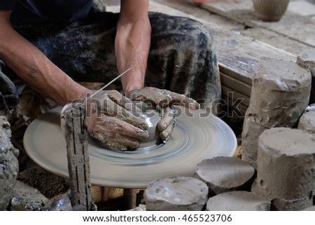 Clay potter creating on the pottery wheel