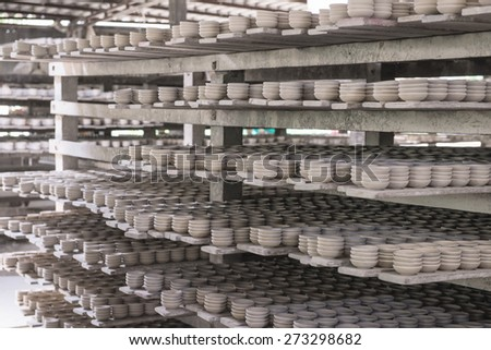 Clay pottery ceramics drying before being fire - stock photo