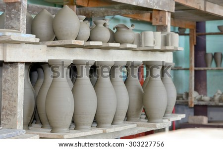 clay pottery ceramics inside of workshop - stock photo
