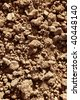 Clay red agriculture textured soil of farm land - stock photo