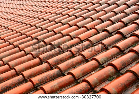 Clay tile on roof of old Bulgarian house - stock photo