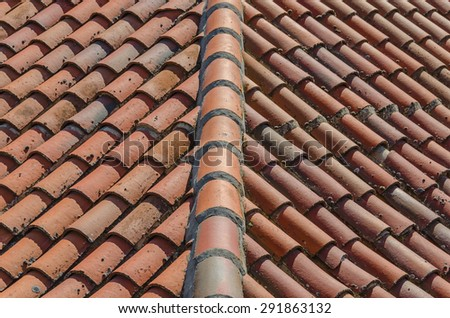 Clay tiles on the roof of a house - stock photo